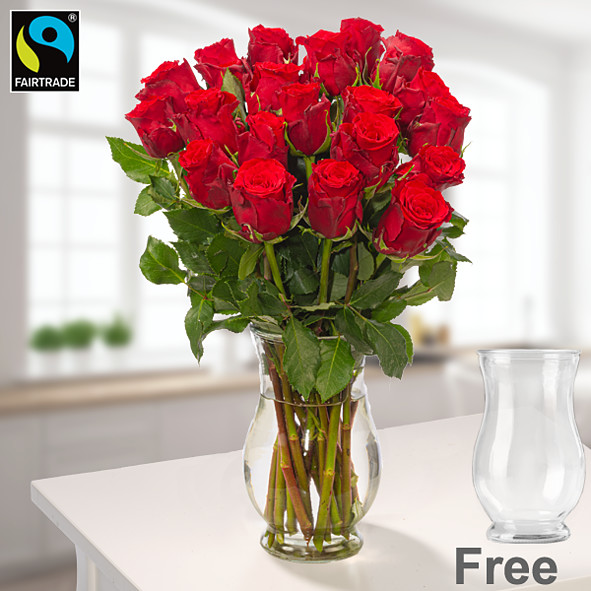 Red Fairtrade roses in a bunch with vase
