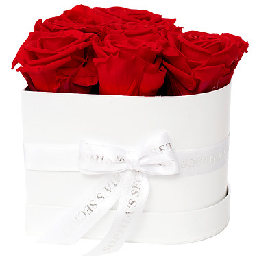 6 red roses in a white heart shaped box