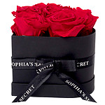 6 red roses in a black heart shaped box