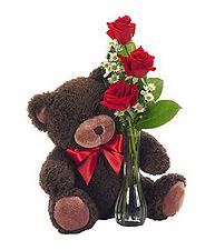 Rosen in Vase mit Teddybär