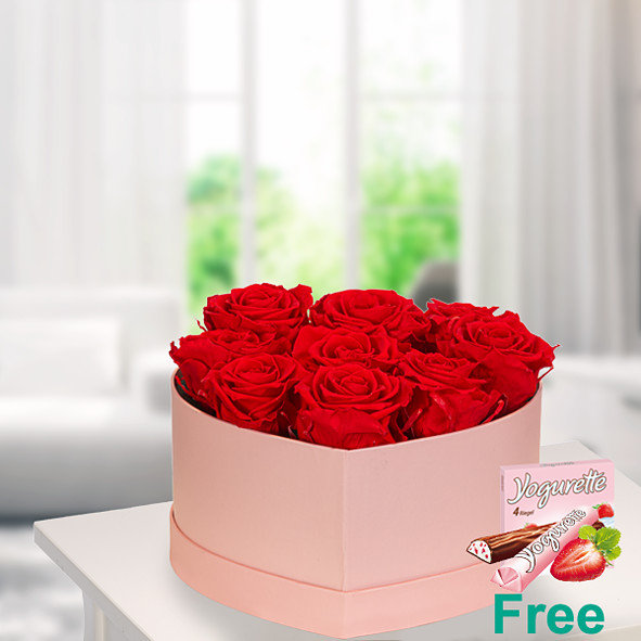 9 red roses in a light pink heart shaped box with Ferrero Yogurette