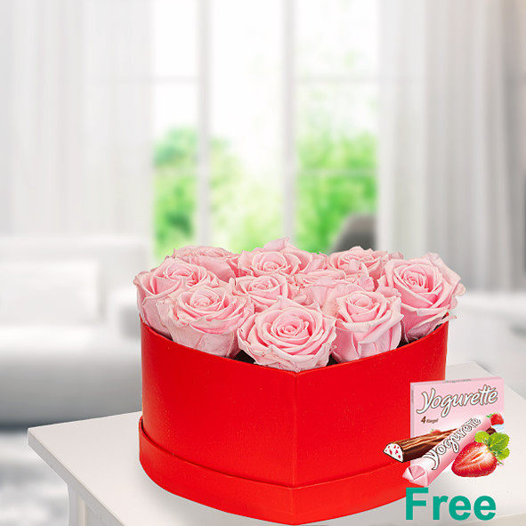 10 light pink roses in a red heart shaped box with Ferrero Yogurette