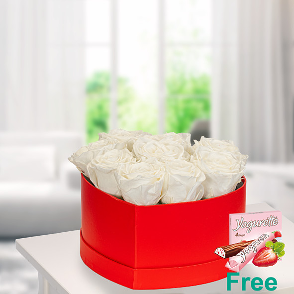 9 white roses in a red heart shaped box with Ferrero Yogurette